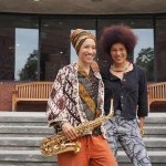 Oxana Chi and Layla Zami (holding a saxophone) standing in front of the Abrons Arts Center