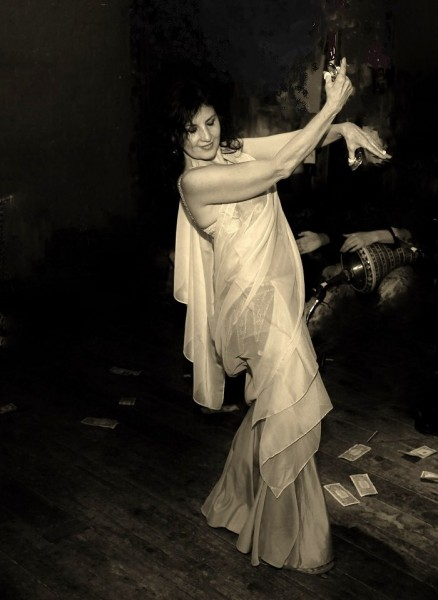 Raqs Sharqi is the classical Egyptian style of belly dance that developed during the first half of the 20th century. Based on traditional folk styles and informed by western influences such as marching bands, the Russian ballet, Latin dance, etc., this hybrid style was performed in the cabarets of interbellum period Egypt and in early Egyptian cinema.