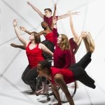 Six dancers with differing physicalities in handstands, leaps, and wheelies