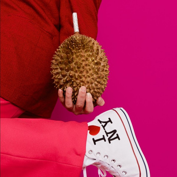 FAMEME holding a durian fruit