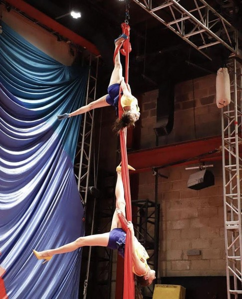 Two aerialists perform on silks