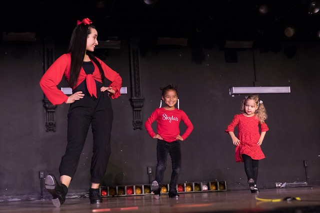 Two young dancers with their Assistant Teacher during our 2018 Youth Program Holiday Showcase.