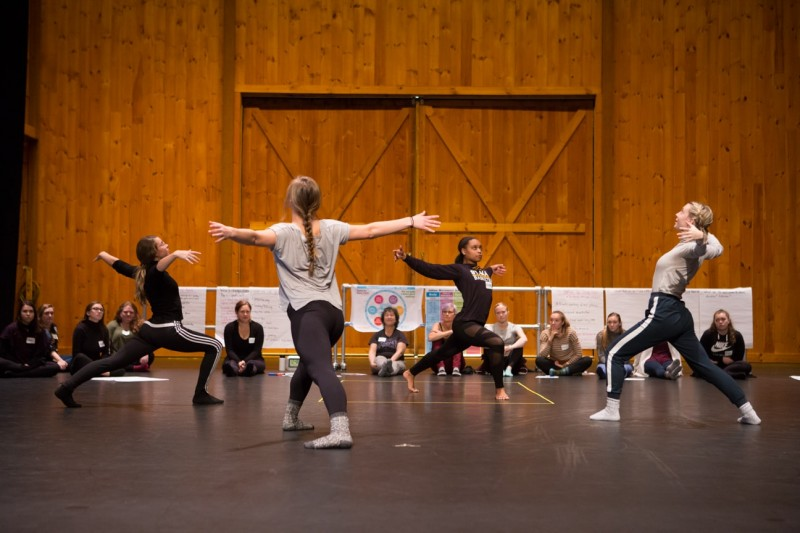 Group of four dance educators performing example of choreography to group