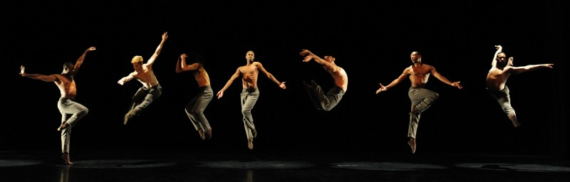 3 male dancers jumping on a stage