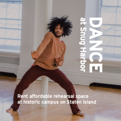 A dark-skinned dancer moves freely in a dance studio