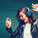 woman dancing with headphones