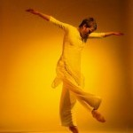 Woman dancing in yellow lighting