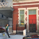 The 122CC building on 9th street and first avenue: the building is painted red, with teal window trims.