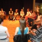 Audience sitting in a circle discussing the performance