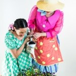 Photo of Daughter and Grandmother with a watering can