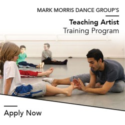 A teaching artist working with children at the Mark Morris Dance Center