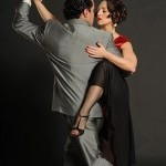 A man and woman embrace as they perform the tango.